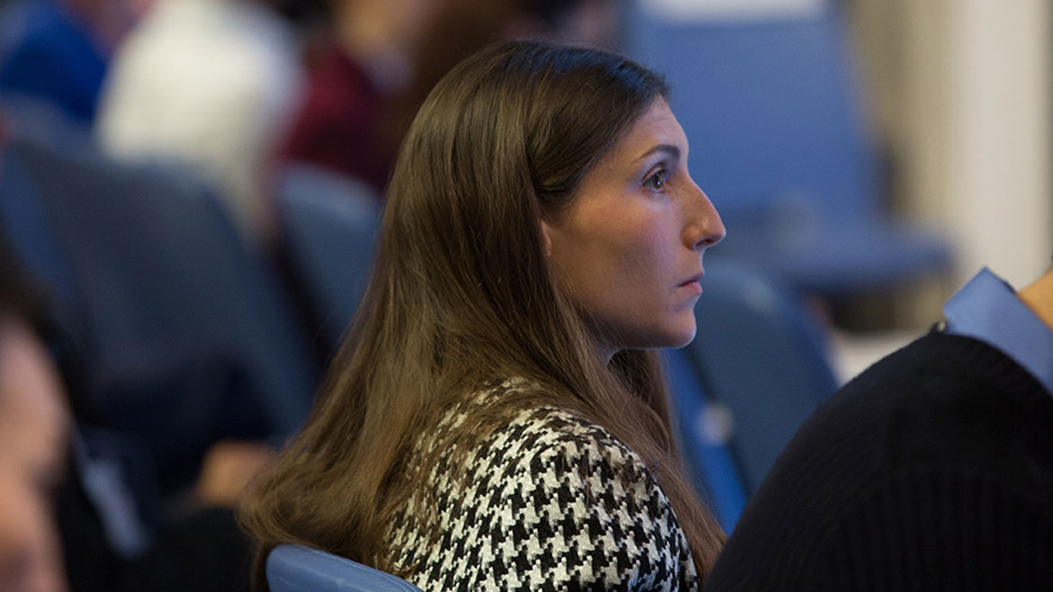 An attendee listening at the Gender and Career Progression conference