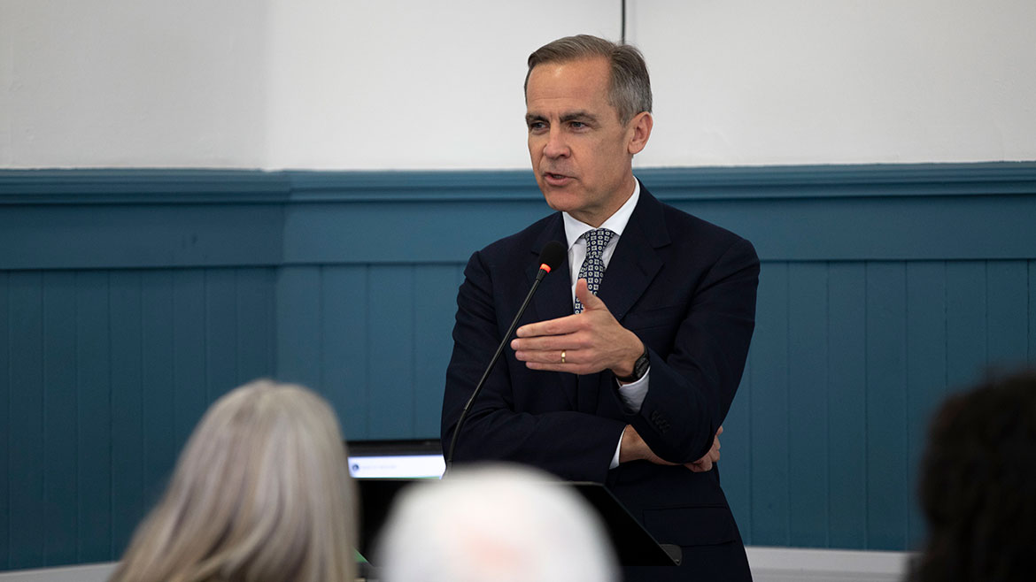 Mark Carney presenting at the Community Forum in Glasgow