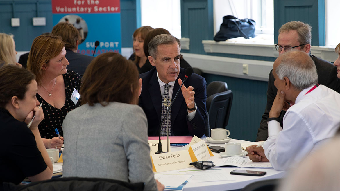 Mark Carney in group discussion at the Community Forum in Glasgow
