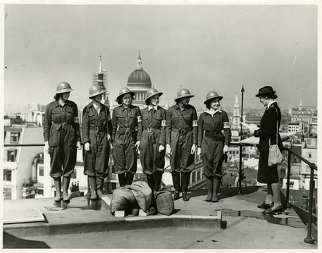 Women Fire Guards practicing on the roof of the Bank, Threadneedle Street 1942 (Archive reference: 15A13/1/4/22)
