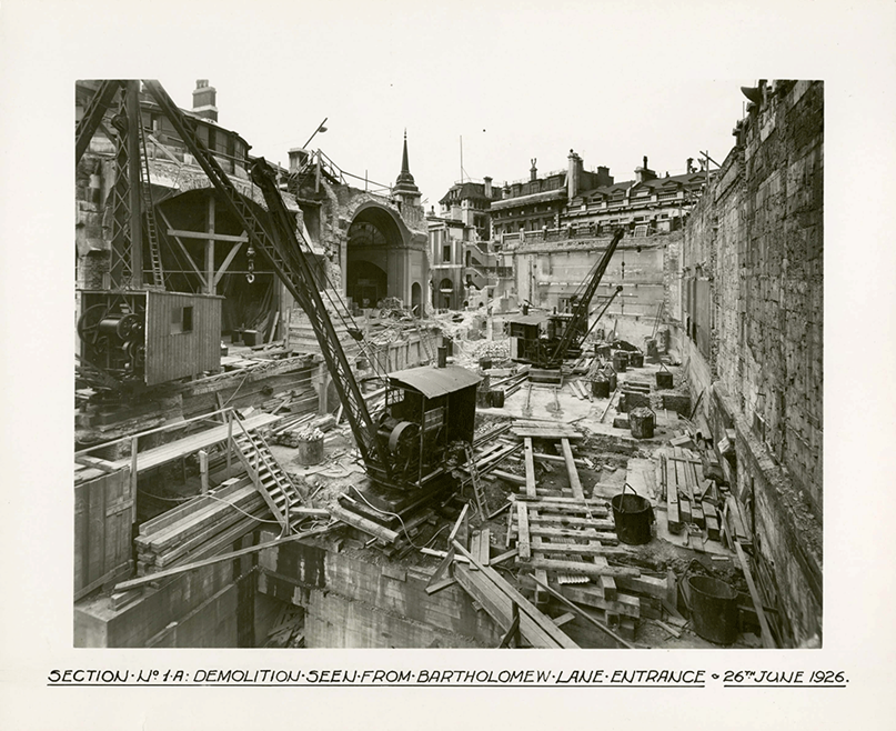 This photograph was shot from the Bartholomew Lane entrance of the Bank and shows the machinery used, and the extent of the rebuilding work during the mid-1920s.