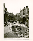 Taken on 29 July 1926 at an early stage in the rebuilding work, this photograph shows the extension demolition with the old façade still standing.