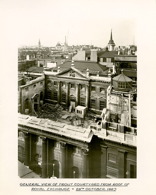 Taken from the roof of the Royal Exchange situated at Bank junction, this photograph looks towards the front courtyard of the Bank of England during demolition in 1927.