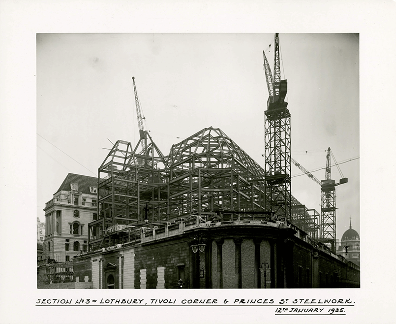 Taken in January 1935 towards the end of the rebuilding work, this photograph shows the scale of the steel construction of the new Bank of England building at Lothbury, Tivoli Corner and Princes Street.