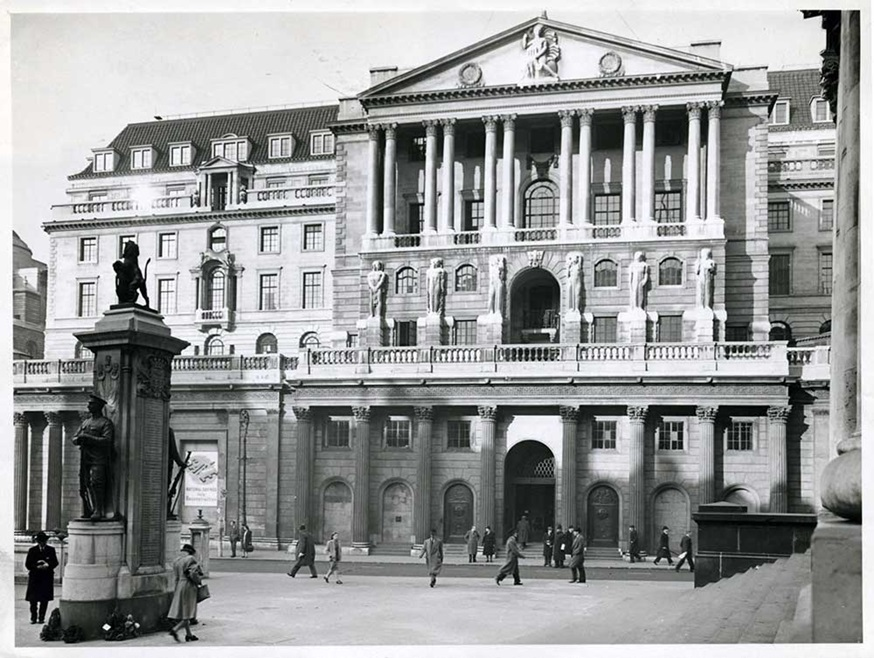 Taken in 1945, this photograph looks across the steps of the Royal Exchange at Bank junction towards the south front of the Bank of England.