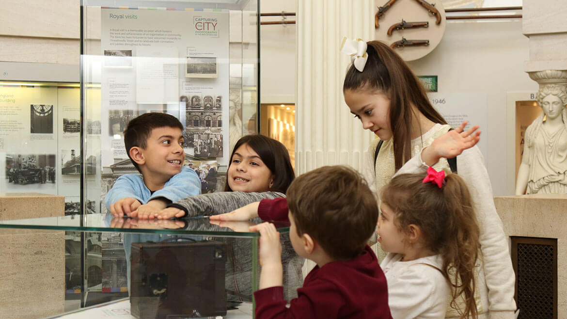 Children looking at the exhibition in the rotunda